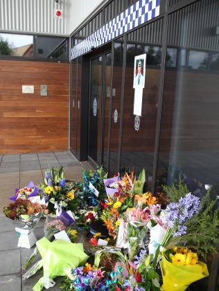 Flowers left outside Windsor police station.