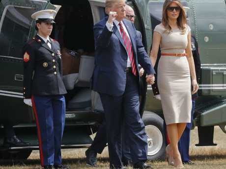 Mr Trump pumps his fist during his arrival in Regent's Park, London, to spend the night at the residence of the US Ambassador. Picture: AP Photo/Pablo Martinez Monsivais