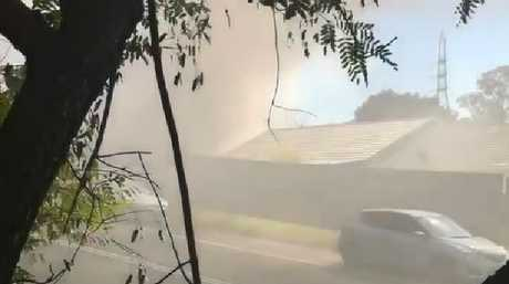 Smoke billows from a Carrara house well involved in flames. Photo: Supplied