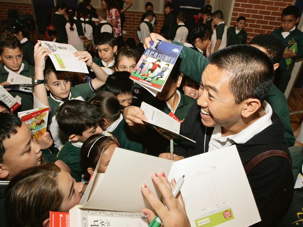 Ahn Do is mobbed by school students at a book signing.