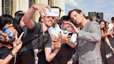 Cavill posing with fans at the premiere of Mission: Impossible — Fallout in Paris this week. Picture: Kristy Sparow/Getty Images