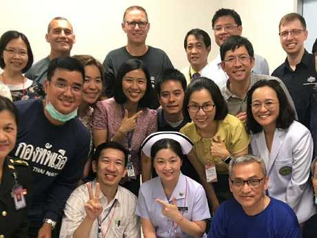 Dr Richard Harris and Craig Challen with hospital staff in Thailand. Picture: Supplied.