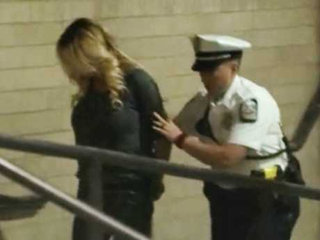 Stormy Daniels is led handcuffed into jail in Columbus, Ohio. Picture: WBNS via AP