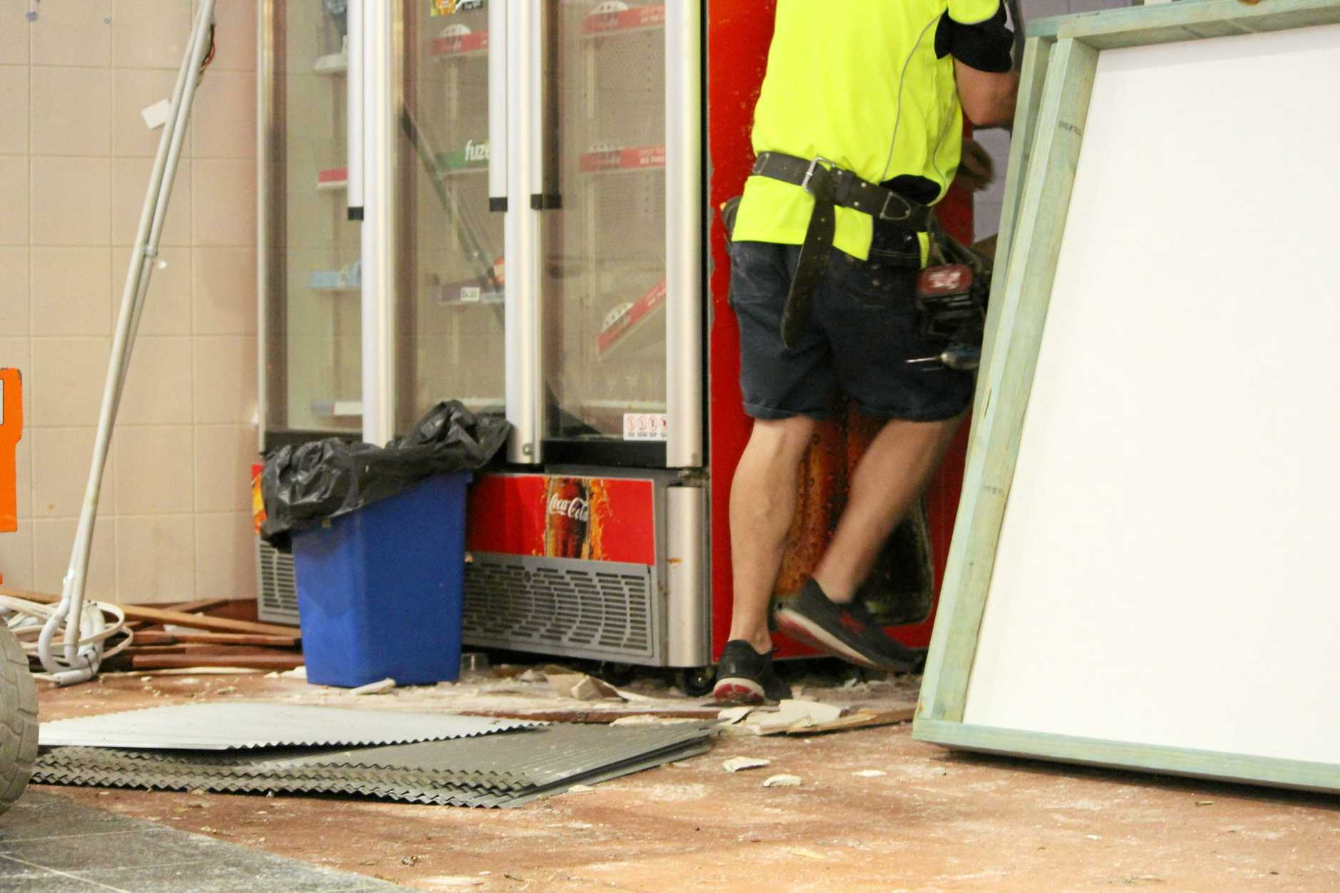 BOARDING UP: Authorised tradesmen cleaning up the carvery the day after it disappeared.