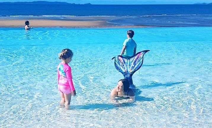 Paige Rigby chats with Khaleesi the mermaid at the Yeppoon Lagoon.