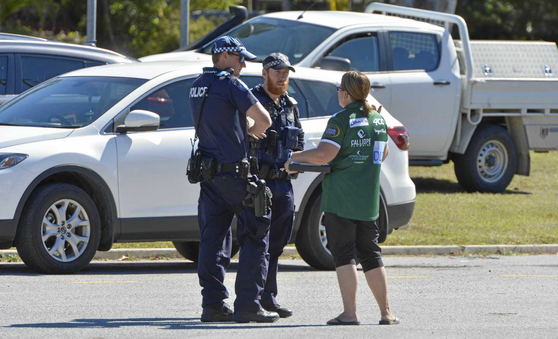 BRAWL: Police speak to a witness after an all-in brawl at the Clinton football fields during an U17 Australian Rules football game
