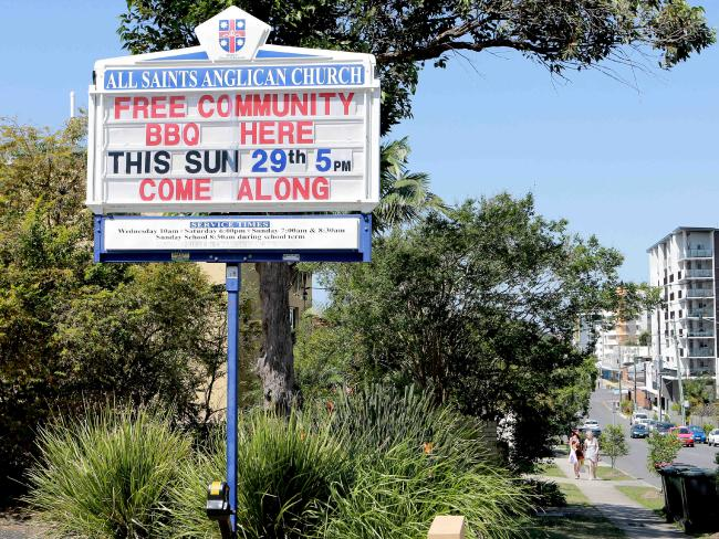 An All Saints Uniting Church sign reads: 'Some people are gay, get over it.' Picture: Mark Cranitch