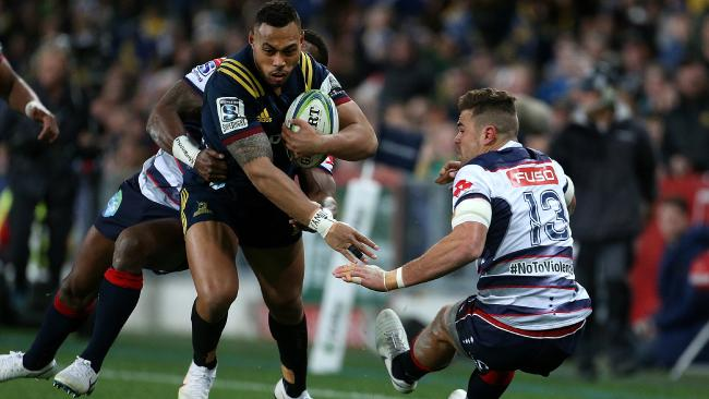 Tevita Li of the Highlanders fends off Tom English of the Rebels. Picture: Getty Images
