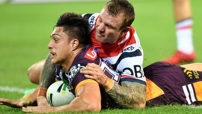 Kotoni Staggs touches down for the Broncos. (AAP Image/Dan Peled)