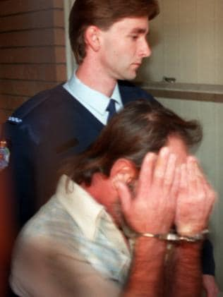 Handcuffed Lloyd Clark Fletcher after being charged with Janet Phillips' murder.