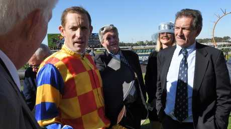 Birthday boy Hugh Bowman talks to connections after his winning ride. Picture: Simon Bullard/AAP