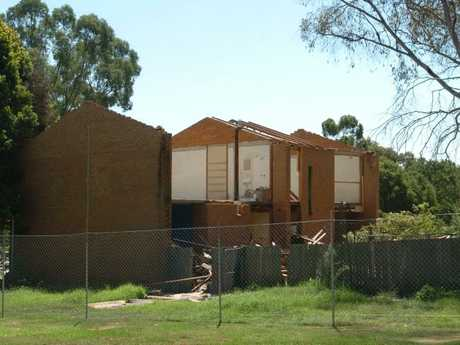 Life in public housing can be very difficult, with social isolation common. Residents are sometimes evicted to make way for new private housing. Pictured here, old public housing homes demolished in Minto, southwest Sydney, to make way for new private homes.
