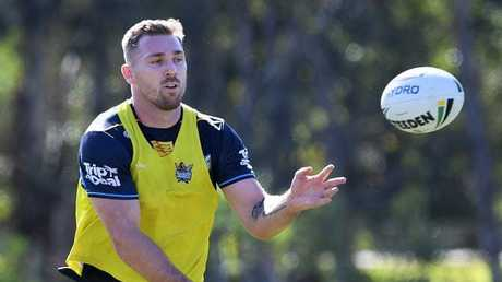 Bryce Cartwright joins in at Titans training. (AAP Image/Dave Hunt)