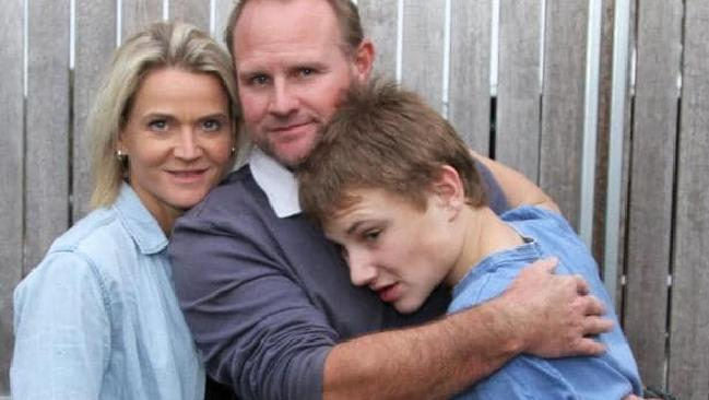 """It can't continue like this"": Liz and Sean Whelan with son Max. Picture: Katie Brannaghan"