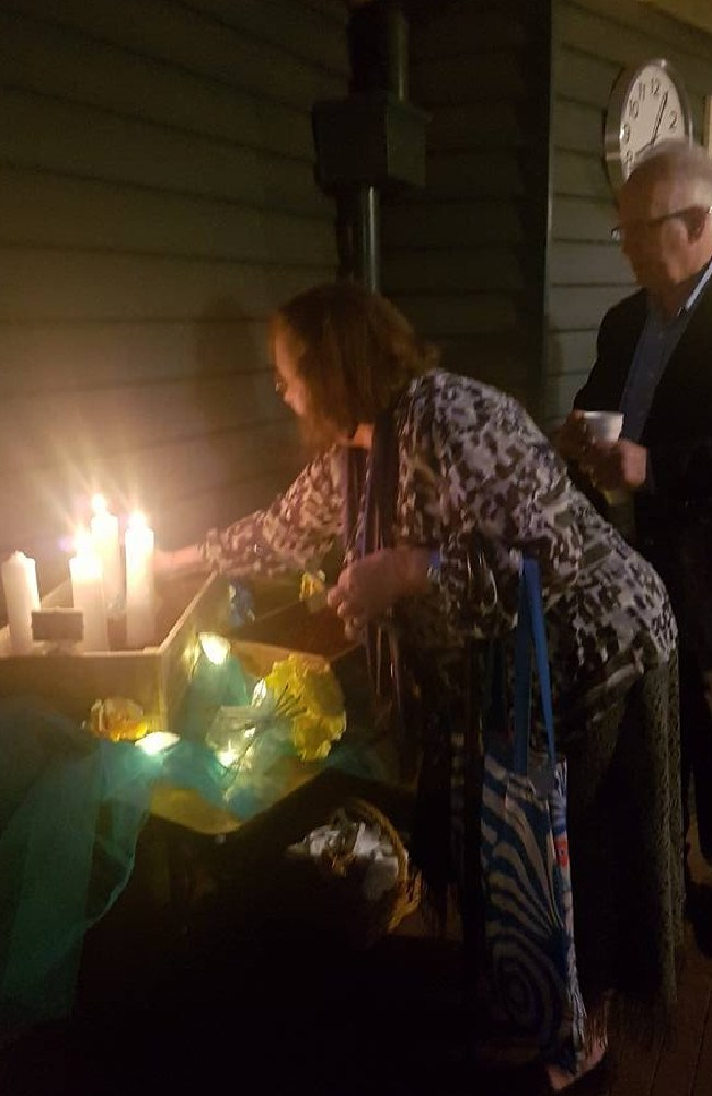Jenny and Steve Dymott light candles in honour of their missing son. Picture: Facebook