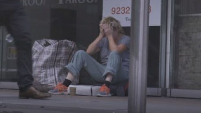 To this … Leckie buries her head in her hands as the emotion takes it toll during filming of Filthy Rich & Homeless. Picture: SBS
