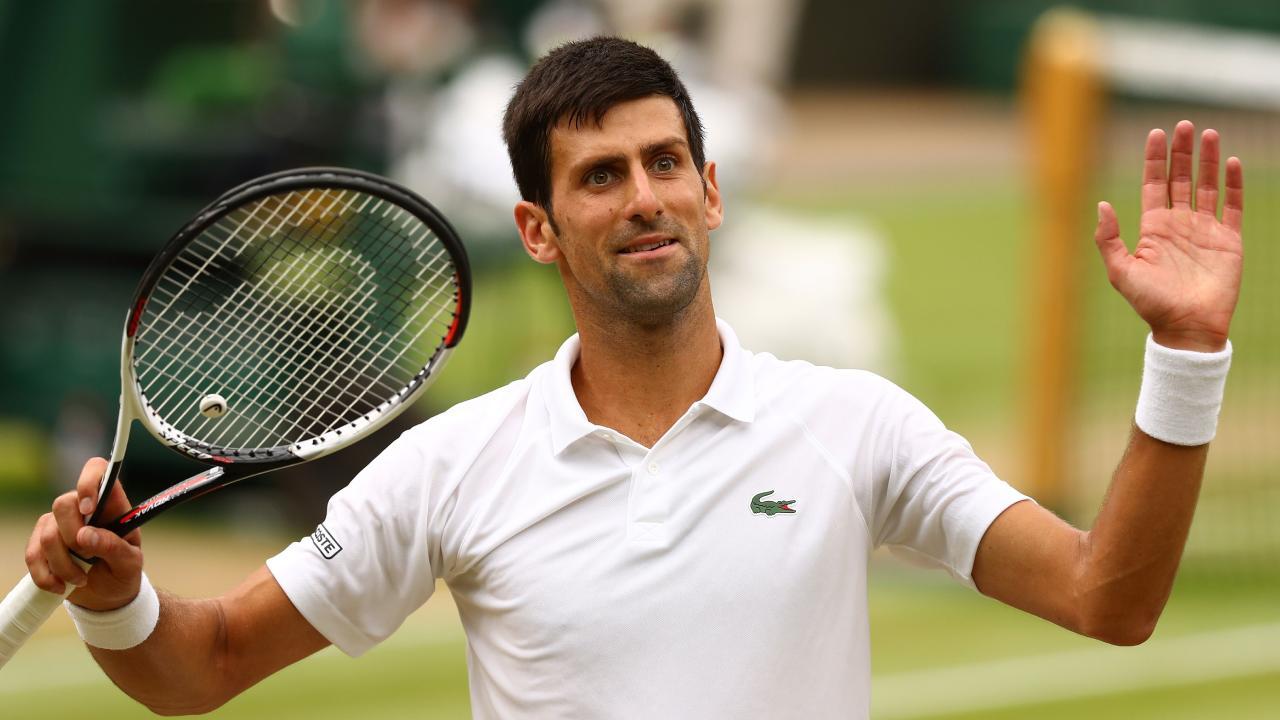 Novak Djokovic celebrates his semi-final win over Rafael Nadal.