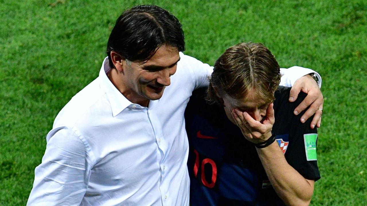 Croatia's midfielder Luka Modric (R) and Croatia's coach Zlatko Dalic celebrate after winning the Russia 2018 World Cup semi-final football match between Croatia and England.