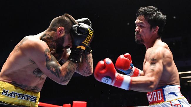 Manny Pacquiao, right, lines up Lucas Matthysse during their world welterweight boxing championship bout. Pic: Mohd RASFAN/AFP
