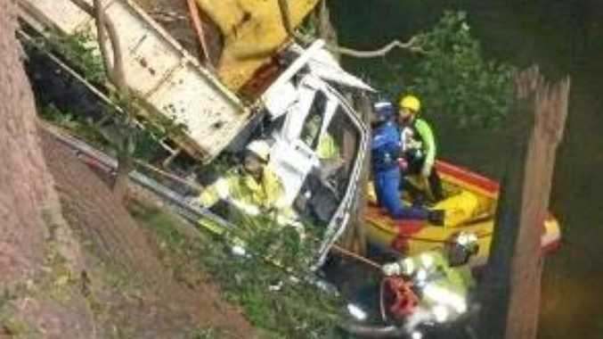 TRAPPED: Driver trapped in truck that crashed down steep embankment