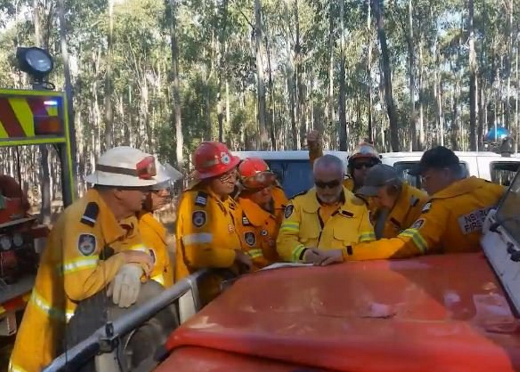 More than 15 crews were called to battle a large bushfire between Casino and Whiporie.