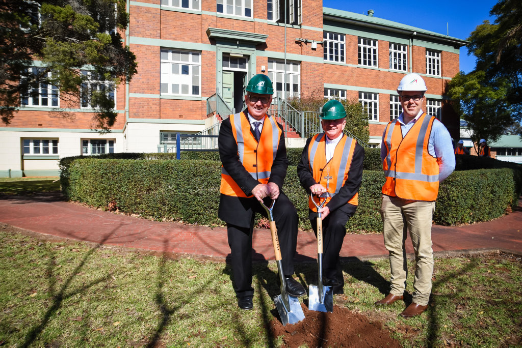 Bishop McGuckin, Dr Pat Coughlan and Steve Kelk (McNab), breaking ground at the former Toowoomba South State School grounds. The building will become home to the Catholic Diocese of Toowoomba's central administration building.