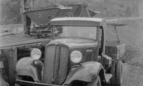 William (Bill) Bosomworth's Bedford truck working on the Mt. Morgan range road, circa 1935.