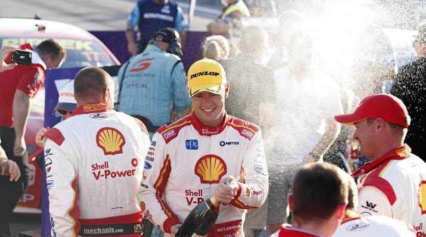 CELEBRATING SUCCESS: Supercars championship frontrunner Scott McLaughlin hopes to be spraying more champagne at Queensland Raceway this weekend.