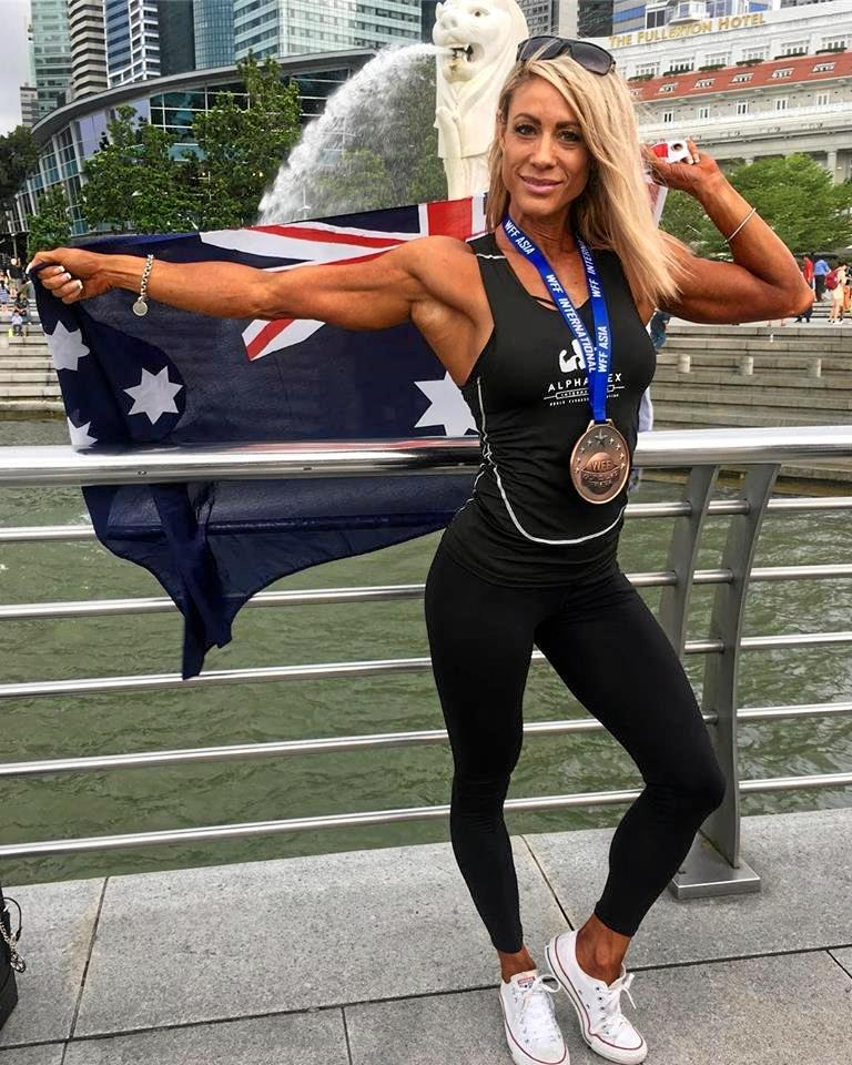 PROUD AUSSIE: Kelli flys the flag for Australia as she takes home third place in the international competition.