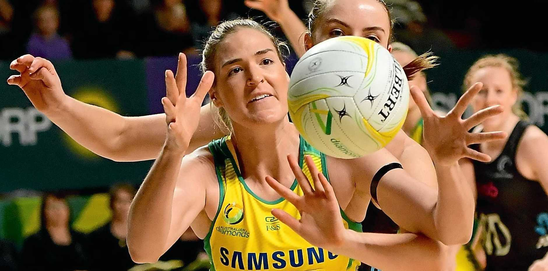 ON THE BALL:  Australian goalshooter Caitlin Bassett catches the ball under pressure from A New Zealander defender during last year's Constellation Cup.