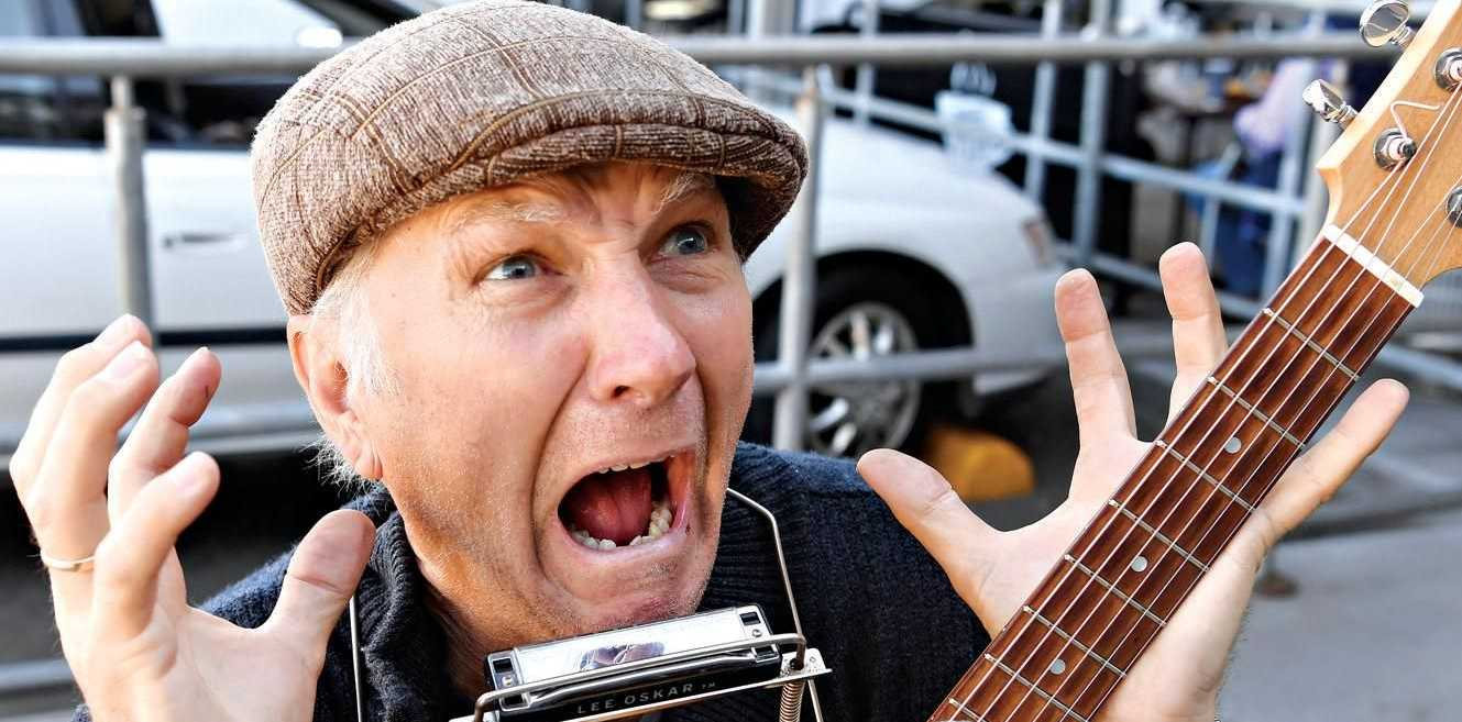 Busker Simon Busmann reacts to the sonic noise