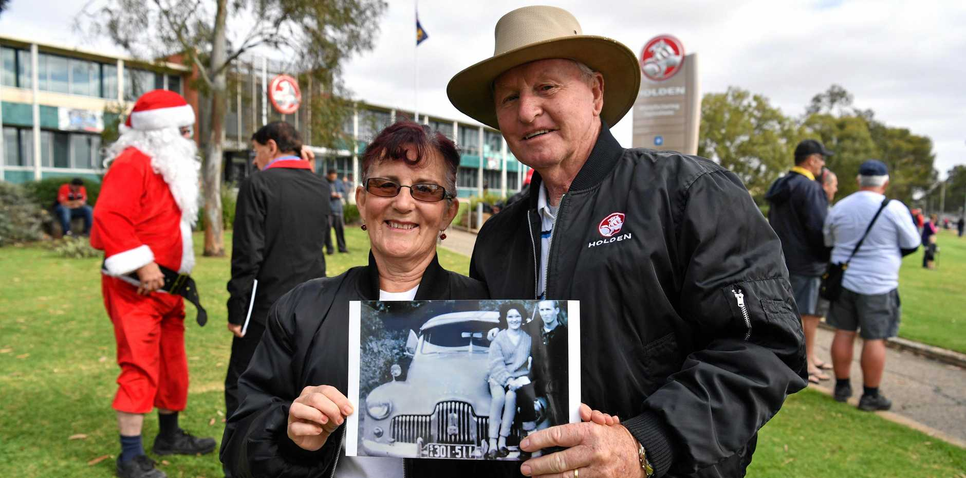 LOST INDUSTRY: Long time Holden Enthusiasts Linda and Maurice McCartney hold a photograph of themselves in their youth outside the Holden plant in Elizabeth, Adelaide on Friday, October 20, 2017. Holden produced its last car in Australia last year.