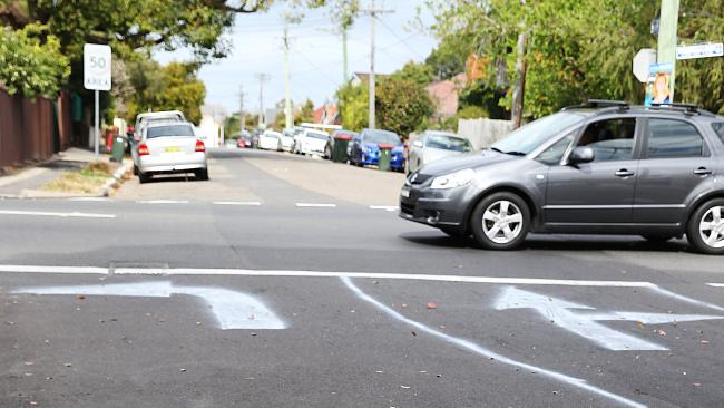 Drivers are so clueless when it comes to corners, that one local resident in Sydney actually hand painted the rules on a busy intersection. Picture: Danny Aarons / AAP