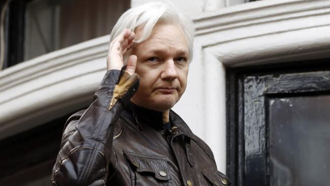 WikiLeaks founder Julian Assange greets supporters from a balcony of the Ecuadorean embassy in London.