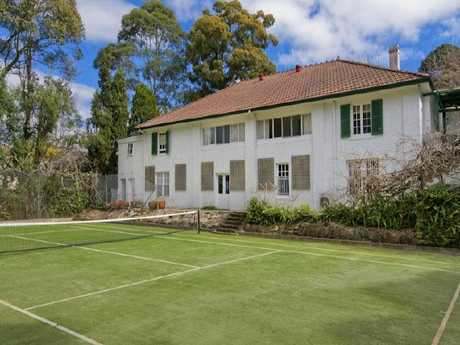 The couple bought luxury houses, including this Pymble mansion and sent their kids to private schools after allegedly skimming $2.9m.