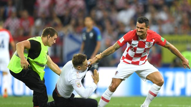 Dean Lovren of Croatia confronts a pitch invader during the 2018 FIFA World Cup Final. Picture: Shaun Botterill/Getty Images