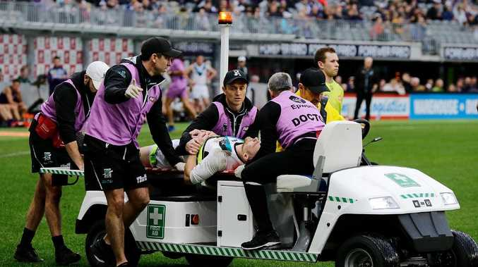 Port Adelaide  Robbie Gray is stretched off the ground during the round 17 AFL match against the Fremantle Dockers. Picture: Will Russell/Getty