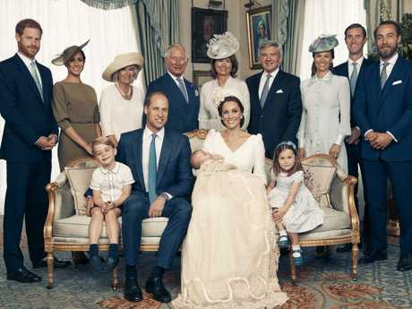 The royal family pose for an official portrait with the Middletons after the christening. Picture: Matt Hollyoak