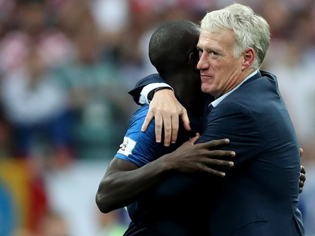 French manager Didier Deschamps embraces N'Golo Kante after the midfielder's substitution in the 2018 World Cup final. Picture: Clive Rose/Getty