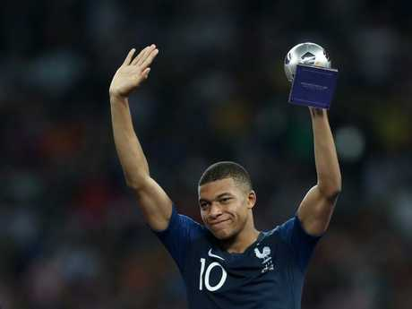 Kylian Mbappe celebrates with his Best Young Player Award. Pic: Getty