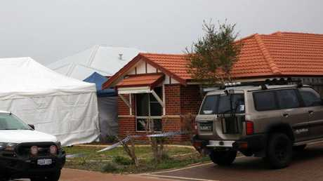 Forensic services attend the scene where three people were found dead in Ellenbrook, Perth. Picture: AAP/Trevor Collens