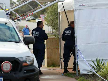Forensic police are seen in front of a house where three people have been found dead in Ellenbrook, Pert. Picture: Trevor Collens/AAP