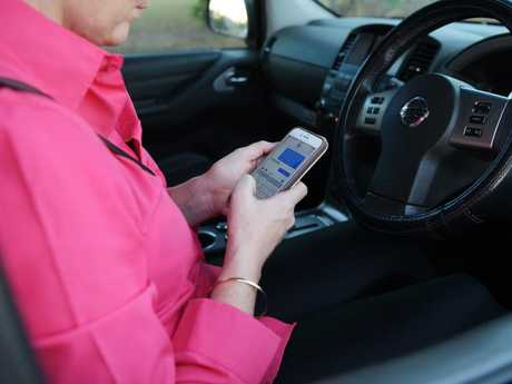 This isn't a good idea … but Australian drivers are actually worse at turning a corner than they are at keeping their hands off their phone. Picture: Keri Megelus