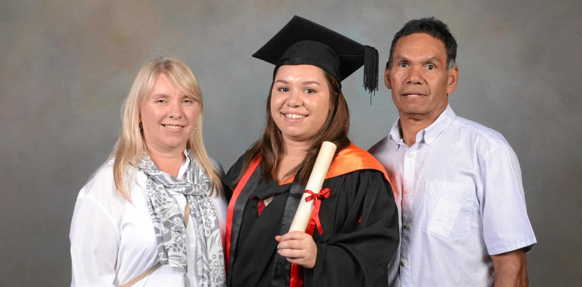 STUDY HARD: Far North Queensland nurse Samantha Watson with her parents Bronwyn and Kevin Watson at her ACU graduation ceremony.