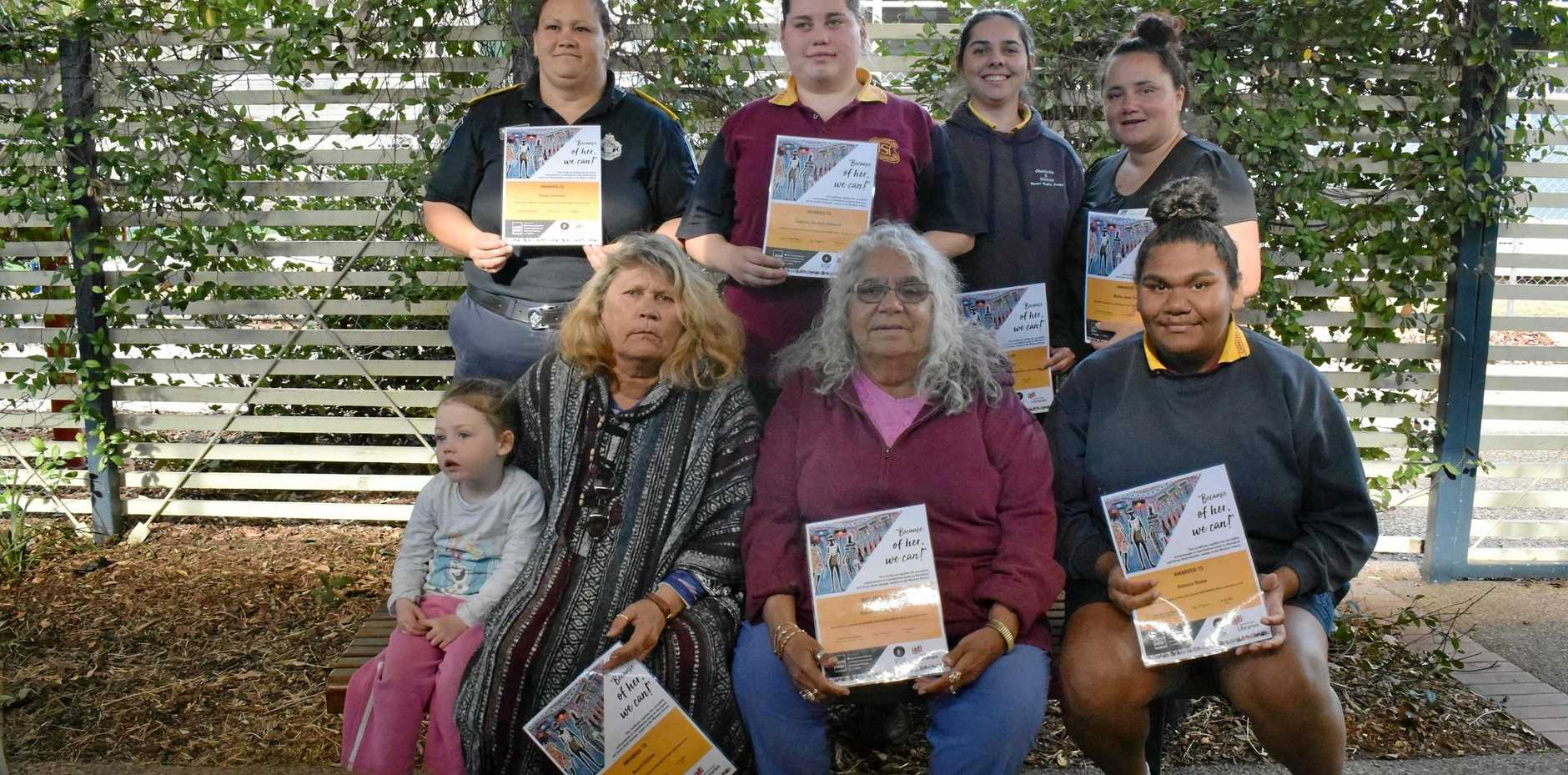 BECAUSE OF HER WE CAN: Kylah Gardner (front, from left), Averil Dillon, Gwenda Lawton, Antonia Roma and (back, fron left) Robyn Jennings, Jasmine Gardner-Allwood, Jaiden Turner, and Billie-Jean Taylor at the Chinchilla Library NAIDOC celebrations.