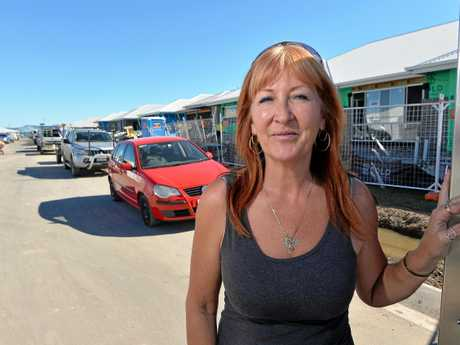 Karen Fisiihoi owns a food truck and spends the bulk of her day weaving through Aura's congested streets.