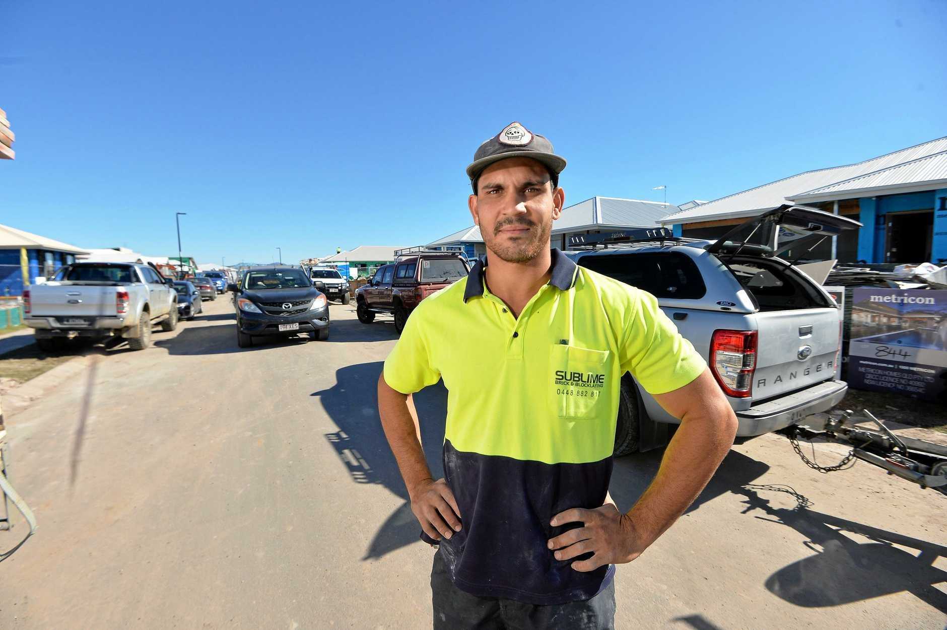 PARKING WOES: Council won't let tradies park on the gutters and there's no room on Beale Street, Caloundra West, with new suburb housing construction. Brodie Sharman works as a bricklayer in Aura almost every day and says he's surprised no one's been hurt yet.