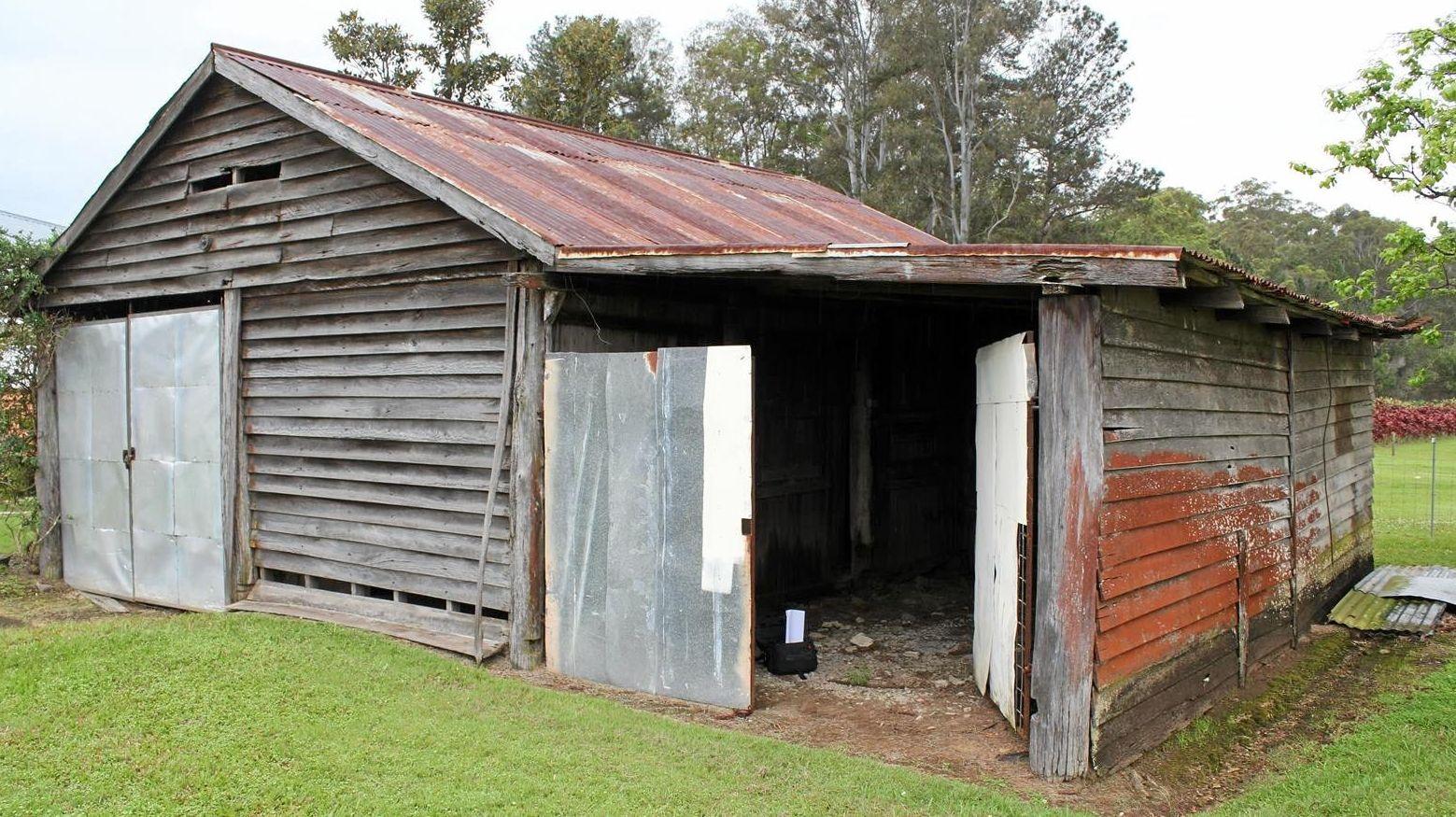 FIXER-UPPER: Restoration of a shed beside Bankfoot House has started at Glass House Mountains.