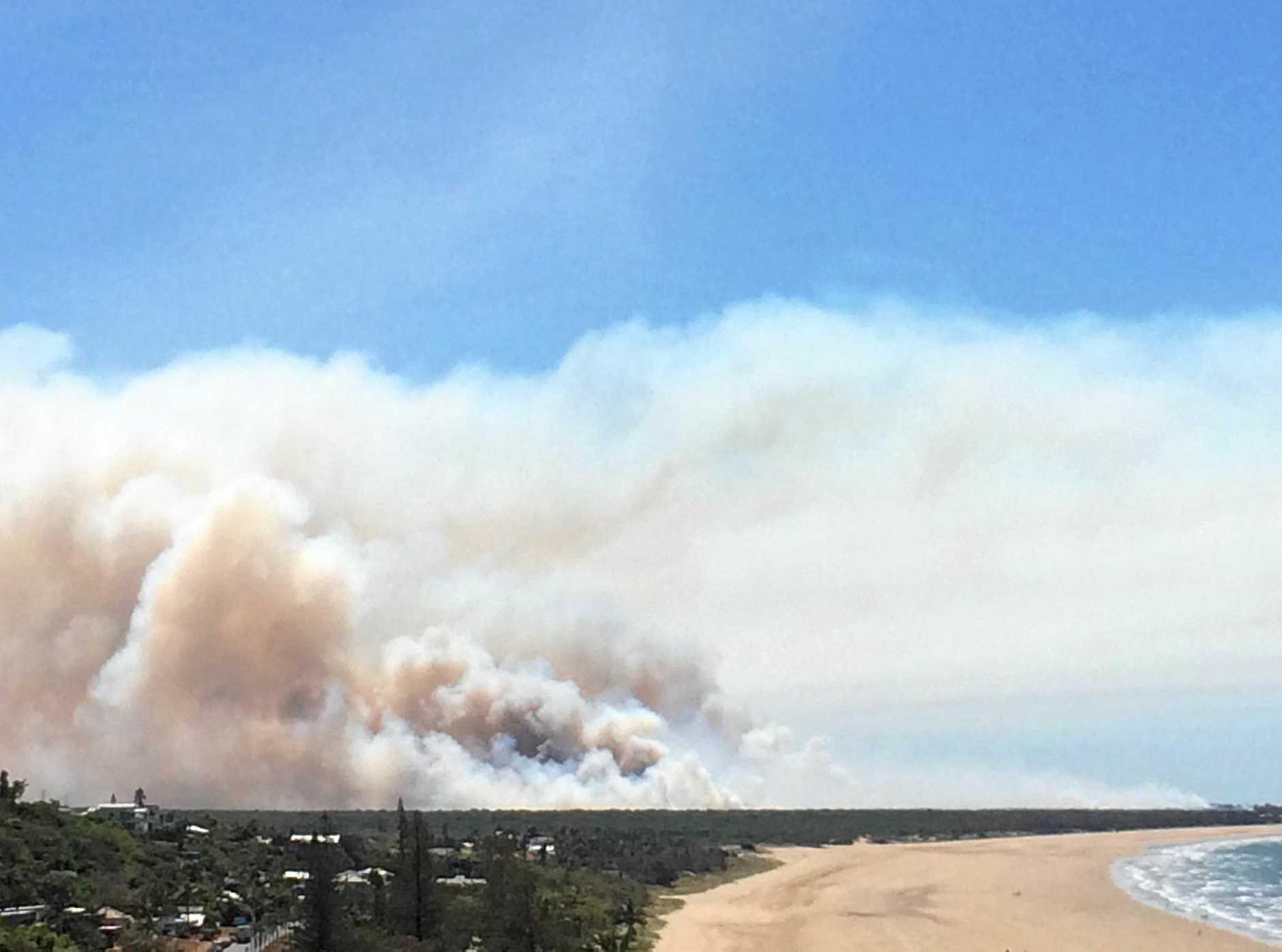 SMOKE HAZE: Smoke billowing from a bushfire near Farnborough Beach.