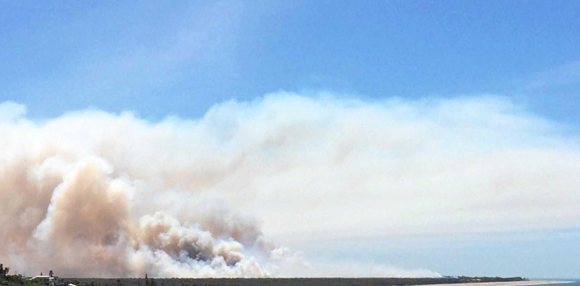 SMOKE HAZE: Smoke billowing from a bushfire near Farnborough Beach.
